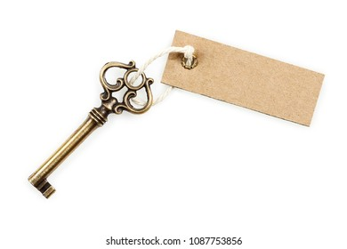 antique key with blank tag isolated on white