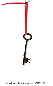 antique key hanging from red ribbon