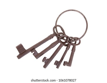 Antique keys on a ring on a white background
