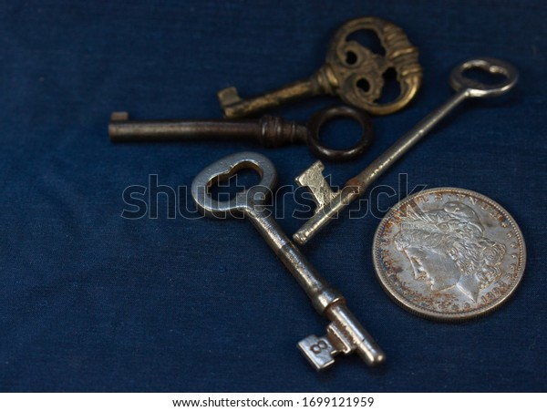 Antique keys and a silver dollar