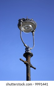 Antique lamppost isolated against deep blue sky