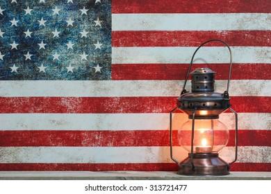 Antique lantern by vintage American flag canvas background