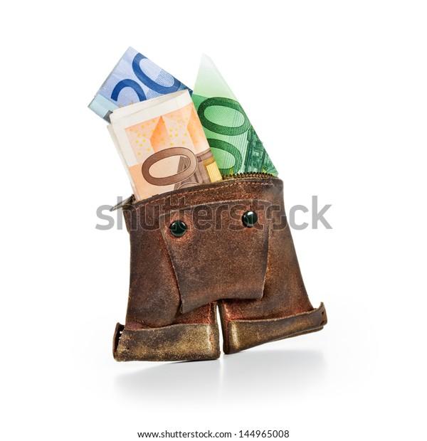 Antique lederhosen wallet with euro notes on white background