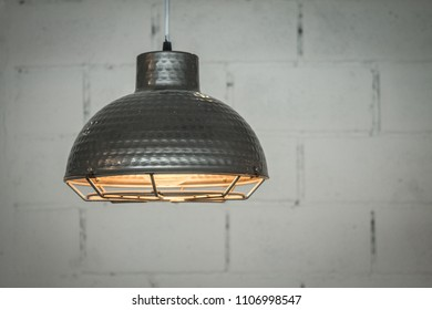 Antique lighting for ambient interior home design.  Old nautical hanging light.
