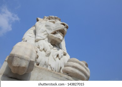 Antique Lion Statue in sky background at Victoria Memorial Gate, Kolkata, India. Built with white Makrana Marbles using the European and the Indo-Islamic style. This was sculptured by Vincent Esch.