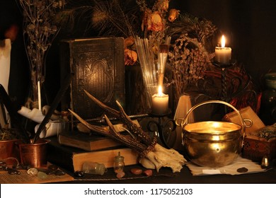 Antique Magic Book. Witchcraft Peacock feathers and candle background. Black candle Magic Ritual