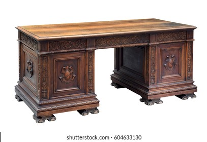 Antique mahogany writing desk with ornate carving on the panels and raised feet for a bureau or office isolated on white