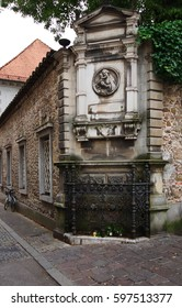 an antique marble altar in honor of the Virgin Mary on a corner on a brick wall in old town of Ljubljana in Slovenia