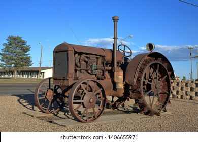 An antique McCormick-Deering tractor on public display in front of a museum along Highway 287 - Dumas, Texas, USA - May 21, 2019