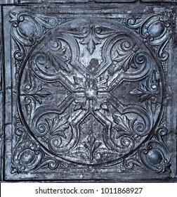 Antique metal ceiling tile with ornate design