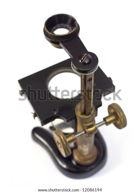 Antique microscope isolated on white.
