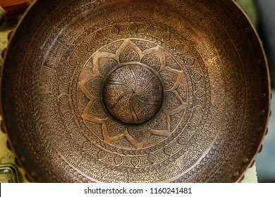 Antique Middle East hand craft bowl with Arabic / Turkish / Persian typography. made from metal Cooper. golden color bowl used as fortune tellers tool. islamic culture. iran turkey arabs culture.