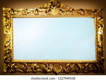 antique mirror with golden wooden carved frame