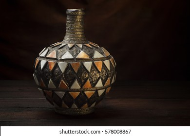 Antique Moroccan vase on an old dark table