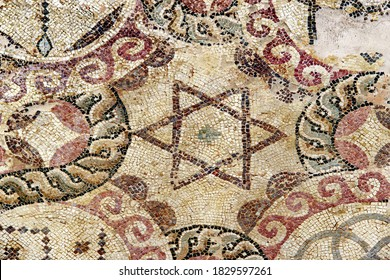Antique mosaic depicting the star of David on the floor of the house of Dionysus. Paphos Archaeological Park. Cyprus.