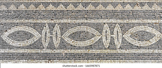 Antique mosaic ornament in the Archaeological Park of Paphos. Cyprus.