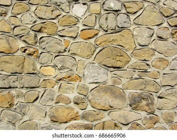 Antique natural stonewall. Stone wall background