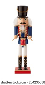 Antique Nutcracker Drummer with a red drum. He has white hair and beard. He sports a black hat, with a blue coat and black boots. The point of view is straight on, and is isolated on white background.