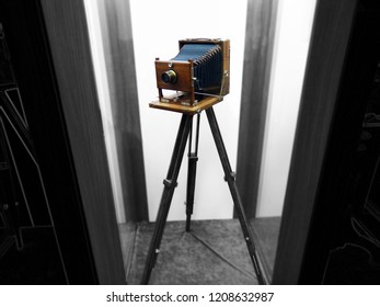 Antique old photo camera with tripod