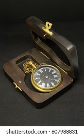 Antique old wrist watch in wood box.Isolated on black background