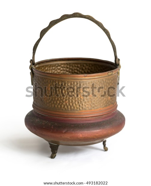 antique open brass pot close up isolated on white background with clipping path