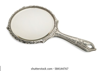 Antique ornate silver hand mirror cut out