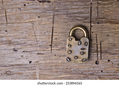 antique padlock on a old wooden table