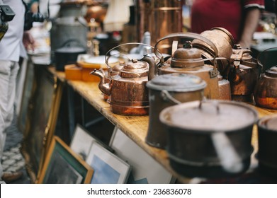 antique pans and pots at the street market in sweden
