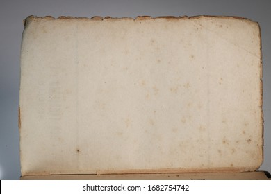 Antique papers. Old aged, stained, vintage and ruined pages. Books from the 1800s.