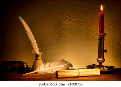 Antique parchment paper sheets roll tied with string lit by candlelight on a vintage colonial wood desk with ink writing feather quill and old candle light in candleholder in master painting style