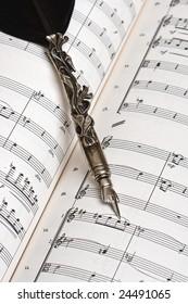 Antique pen and musical score