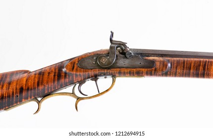 Antique percussion mountain rifle made around 1840 with tiger maple wood and double set triggers in 50 caliber.