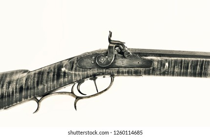 Antique percussion mountain rifle made around 1840 with tiger maple wood and double set triggers in 50 caliber in black and white.