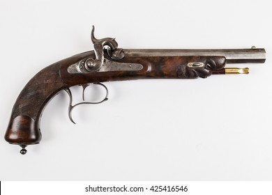An antique percussion pistol on a white background (not isolated)