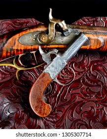 Antique percussion rifle and  pistol made around 1840.