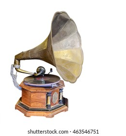 Antique Phonograph, retro old gramophone with horn speaker for playing music over plates isolated on white background. This has clipping path.