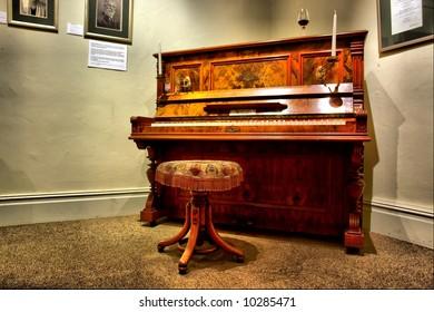 Antique piano in museum - dramatic light. Shot in Stellenbosch, Western Cape, South Africa.