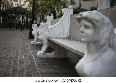 an antique plaster woman's bench in Paris, France.