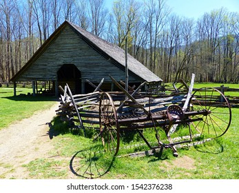 An antique plow sits in front of an old barn at the Oconaluftee Farm Museum at the Great Smoky Mountains National Park near Cherokee, North Carolina.