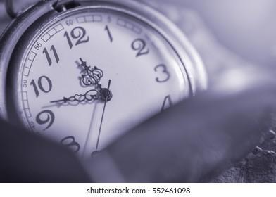 Antique pocket clock on dried leaf, Concept of time