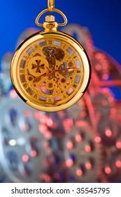 Antique pocket watch on brown textile.