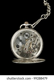 Antique pocket watches mechanic on chain with jewels inside isolated on black background.