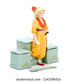 Antique porcelain boxes for cosmetics with figurines. Isolated image.