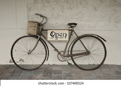 Antique push bike used for an open sign for an Antique shop.