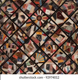 Antique Quilt, richly textured from many pieces of fabric, circa 1886.