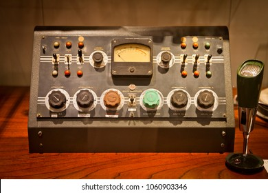 Antique radio broadcast set with microphone, Old console with switches and dials for radio announcer.