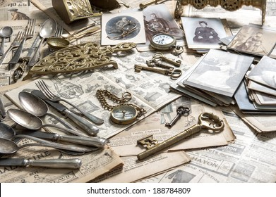 Antique rarity goods, private collection. Old cutlery, clock, key, photos. Collectibles. Shabby chic. Selective focus