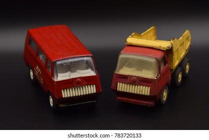 Antique Red Toy Trucks on Black Background