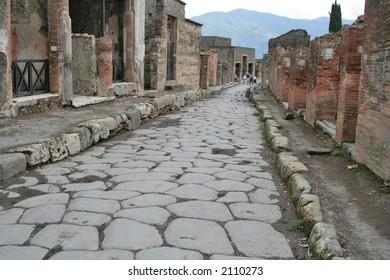 An antique roman stone street through ruins of Pompei,Italy.