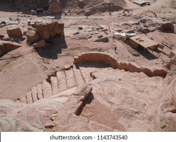 Antique sandstone ochre stairs in Petra Valley on a scorching Summer day - Jordan